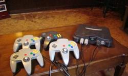 Game console with 4 controller and extra memory with tons of games. See pics.