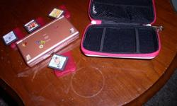 its a pink DS lite includes 4 games (Art Academy, Hamsterz,Cooking mama and mario party)charger and case some scratches