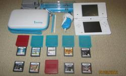 Nintendo DSI (white) with case, docking station, car charger, and 9 games:   Call of Duty Black OPS Transformers Autobots Indiana Jones 2 Transformers Decepticons Mario vs Donkey Kong Spider-Man Web of Shadows Bionicle Heroes Super Mario Bros Mario &