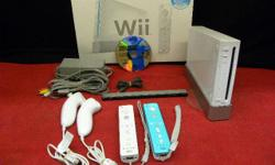 Nintendo Wii Game System with 2 controllers and Tiger woods PGA Tour 08, model #RVL-001, ITEM #145108-17. With 2 steering wheels, base ball bat, tennis racket and golf club. Price of $106 includes all taxes. PLEASE REFER TO INVENTORY #145108-17 WHEN