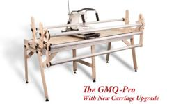 Turn your domestic sewing machine into a quilting machine with this quality Grace Company GMQ Pro no-baste frame.  Wood construction with 4 aluminum rails.  Adjusts from crib to queen to king size.  Folds up for easy storage. (shown in picture below)
