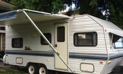 1997 nomad travel trailer bunkhouse. 20 feet. Model 2060. Sleeps 7. Four bunks in rear with large closet. Table folds down to large bed with fold down bunk above. Bathroom complete with tub and shower, also exterior shower hook up. Kitchen has three way