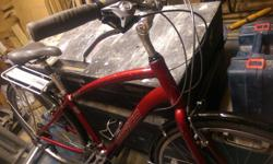 Red 21-speed Norco city bike. Newly cleaned and tuned. New chain. Includes rack, fenders, and handlebar pannier. Reliable for commuting and recreation. Many miles left on this fine steed. Come take er for a rip and see if its a fit!