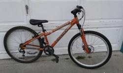"""2007 Norco Mountaineer in good condition. Aluminum frame is 12.5"""" - fits a person about 4'10 to 5'5"""". 26"""" wheels, disc brake on front only. Front suspension. Shimano components - 21 speed Text if possible - 250-618-2473"""