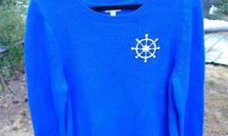"Here is offered a terrific nautical themed sweater featuring a ship's wheel logo. Size Women's XXL. Beautiful royal blue color. Chest measures 21 1/2"" flat armpit to armpit. Sleeve length is 28"". 60% Cotton 40% Acrylic. Machine wash inside out cold"