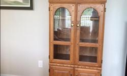 """Oak Cabinet with lots of storage to display your collectibles. 18"""" D x 29"""" W x 76"""" H Very Good condition solid oak doors and trim with adjustable shelves."""