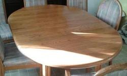 Solid oak - 1inch thick!! Includes 6 chairs (two are arm chairs) Measures 66in x 45in plus two 18inch leafs. $450 OBO
