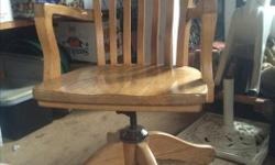 Comfortable, solid oak swivel chair on rollers