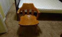 Nice and solid oak office chair with four legs.