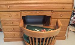 Immaculate oak roll top desk $500, chair $150.