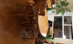 """Solid oak table & 4 chairs. Table is 42"""" with 18"""" leaf & brass fittings."""