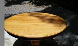 Oak pedestal table with two leaves. Comes with six chairs.
