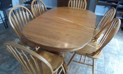 solid oak table with 6 chairs 2 center leaves