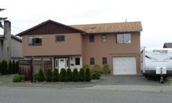 # Bath 3 Sq Ft 2500 MLS 410493 # Bed 4 Enjoy the ocean and Coastal Mountain views relaxing on your deck under your aluminum and glass patio enclosure that was just installed in 2015. This spacious 2500sqft 4 bdrm 3 bath home has lots of room for a family
