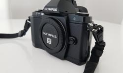 It comes with original strap, battery, charger and it is in mint condition. https://www.dpreview.com/products/olympus/slrs/oly_em5 Body type - SLR-style mirrorless Max resolution - 4608 x 3456 Effective pixels - 16 megapixels Sensor size - Four Thirds