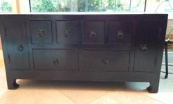 Solid and beautiful Korean Chest (brought back from overseas) with pull out drawers accessible from front and back. We used it as a TV unit, but really it can be a stand alone piece. Moving to a condo and unfortunately we don't have space for it.