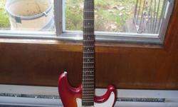 Pretty cool guitar, sounds great AND happens to be a superb learning tool. Has a few dings but nothing terrible. Vintage cherry burst that got sort of washed out in the harsh light of my cameras flash. It's a good looking, very well built guitar that