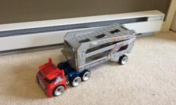 Optimus prime rescue bot hauler - hardly played with. Like new condition.
