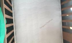 Clean organic cotton crib mattress with coil springs for sale, made in Canada. Comes with a mattress protector and a couple sheets $60. Wooden convertible crib also available for $25 or take the whole package for $80, we need space in our house for big
