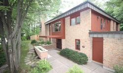 # Bath 1.5 # Bed 3 Architect designed, mid-century Prairie House-style home. Grand foyer leads to towering sunlit atrium surrounded by gallery. Stunning craftsmanship, built-in cabinetry and 4 skylights. Real 'wow' power with large entertaining spaces,