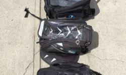 Several Oxford Luggage tank bags and a smaller tail pack. Prices are $30 to $40