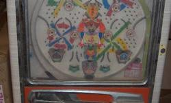 Pachinko (�?p�?`�?â??�?R?) is a Japanese gaming device used for amusement and gambling. A pachinko machine resembles a vertical pinball machine, but with no flippers and a large number of relatively small balls. The player fires a ball up into the