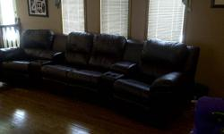 Leather Paliser theater style seating couch with 4 reclining chairs, 2 storage holders each with 2 cup holders.