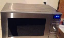 "Like new, clean Stainless Panasonic INVERTER Microwave with grill feature Model no. NN-GD693S 1100 W approximately 21"" X 12"" X 16"" Only few months old, did a kitchen reno, do not fit my current space.$ 150.00"