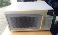 "White Panasonic microwave oven, 20"" wide x 12"" high."
