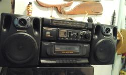 This is a ghetto blaster with single cd and cassette player/ recorder, also a strong tuner to pick up radio stations . Takes batteries or plugs into the wall. In like new condition and sounds great. Would be a perfect work site radio music player. Asking