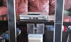 Full surround sound with speakers, woofer and remote. Plays CD's, DVD's and hooks up to TV