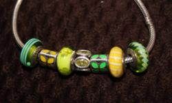 7 Pandora beads ( bracelet not included) I will sell beads separate or together from left to right: -retired murano glass paid $50 plus tax, selling for $35 -retired yellow enamel paid $55 plus tax, selling for $40 -green flower murano glass paid $50 plus