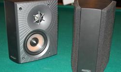 A pair of Paradigm Cinema ADP 3.v speakers. Unsused.