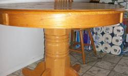 Pedestal dining table and 3 chairs for sale. Good condition, very sturdy. $50 OBO Thanks!