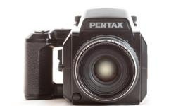 Pentax 645N with 120 Film Back and extra film holder. The lens that comes with the camera is the 75mm f2.8 autofocus Pentax lens. A cool film camera for portraits and landscapes. Offered at $960. If you want a complete system with 2 camera bodies and a