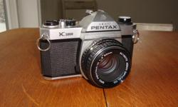 Pentax K1000 35mm camera in excellent condition.