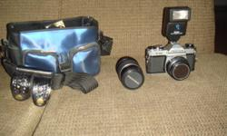 FOR SALE Pentax K1000 film camera with: 50mm lens a Vivitar 16A Automatic Flash an extra Pentax 135 mm lens roll of Kodak HD film and camera case Always well taken care of and in good working condition!