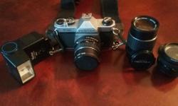 Selling 1 Asahi Pentax SLR Film Camera with assorted lenses: Pentax 1:2 55mm Pentax-M 1:3.5 135mm Kalimar 1:2.8 28mm Meter does work.
