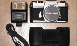 The Pentax SLR camera and lens (genuine Pentax Super-Takumar 1:2/55 mm) are in excellent working and cosmetic conditions. Included in the package are one flash unit, an original Pentax strap, a Pentax metal lens cap and a leather base case. Button battery