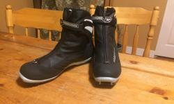 Rossignol Women's Classic Ski Boot, Size 43 EU (W's 11). Like new, selling because they are a bit small for me. Don't be deceived by the size of the boot, once you have thick socks on there is a lot less room. I recommend these boots for someone who takes