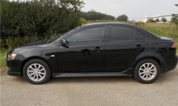 Make Mitsubishi Model Lancer Year 2011 Colour BLACK kms 85487 Trans Automatic 2011 Mitsubishi Lancer De/ES are powered by a peppy 2.0 Liter Engine. CVT transmission. Offering a sporty ride at an affordable price. Check out this 2011 Lancer with Power