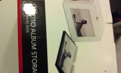 With swivel base, white. Contains 4 albums that hold 20 photos in each. This ad was posted with the Kijiji Classifieds app.