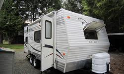 2008 Pioneer 20ft Travel Trailer Excellent Condition. Modern interior. - Sleeps: 6 Queen bed, single bed, dinette and couch/futon. - Kitchen includes: 3 burner stove, large 3 way fridge, freezer, double sink, plenty of counter space and storage. -
