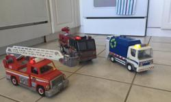 Playmobile fire truck and recycling truck with drivers. Tonka fire truck. All lights work! $25.00 for all three.