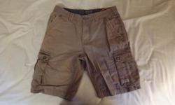 Point Zero Size 32 Men's olive green cargo shorts. They sit at knee, but you can fold up seam at bottom to make them sit just above the knee like I did. No holes, rips or stains, just some color fading from washing and drying. They come with matching