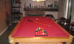 Oak Dufferin 5 X 9 Slate Pool Table 2 sets of balls, cues and rack All in excellent condition Also available is a pool light for $250