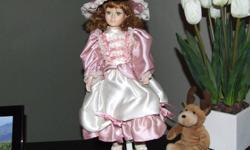 2 porcelain dolls for sale in excellent shape. Selling for $25 each.