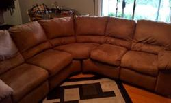 Electronic/power reclining sofa. Asking $900 O.B.O. Sofa has one large blemish on the back which is a candle wax stain. We love this couch but need it gone, it is too small for our expanding family.