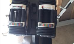 Powerblock adjustable dumbbells (5-70lbs) great condition. have to sell due to moving. comes with stand.