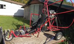 This is a production Powered Parachute unit with seating for two people. Unit has been well cared for and stored. Comes with the trailer to transport. Available for viewing, can be started and basic ground display, no test pilots. Rotax 2-Stroke motor
